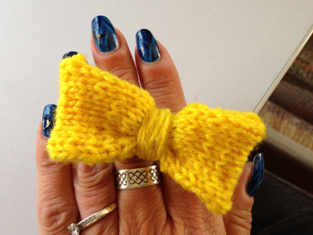 Hand knitted bright yellow bow